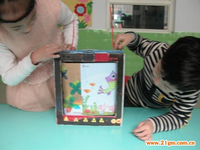制作步骤:   1,利用废弃包装纸盒制作电视机